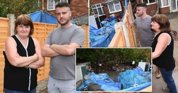Family's hell living next to mountain of rubbish that 'smells like a sewer'