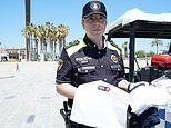 Barcelona police hand out kits with emergency clothes inside to swimmers who are robbed on the beach