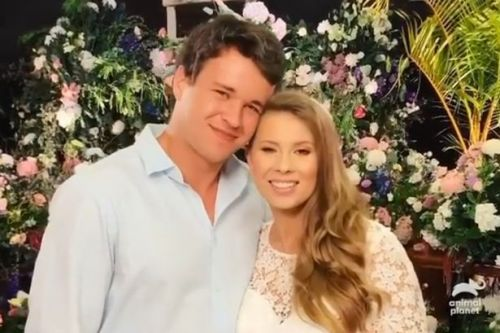 Bindi Irwin shares flowers with Australia Zoo staff after rushing wedding