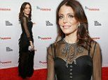 Bethenny Frankel is stylish in black gown with semi sheer sleeves and layered skirt at gala in NYC