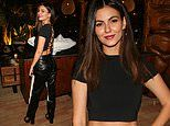Victoria Justice rocks a backless crop top with black leather slacks for beach house event in Venice
