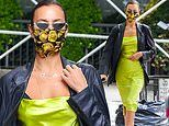 Irina Shayk owns the sidewalk in a striking lime green ensemble as she makes her way through SoHo