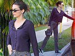 Kendall Jenner goes casual in purple top with faded black jeans as she departs photoshoot in Miami