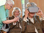 Duchess of Cornwall road-tests a pair of VR goggles during a visit to a hospice in Swindon