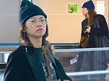Zendaya attempts to fly under the radar as she hustles through JFK airportin a low-key look