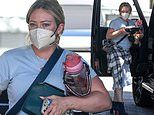 Hilary Duff flashes leg in blue dress as she arrives at LA salon with food, book and water bottle