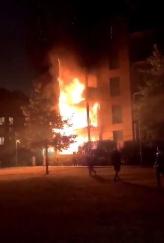 Dozens of firefighters tackle huge blaze at block of flats in East London