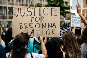 'How have the police officers involved in Breonna Taylor's killing not been charged?'