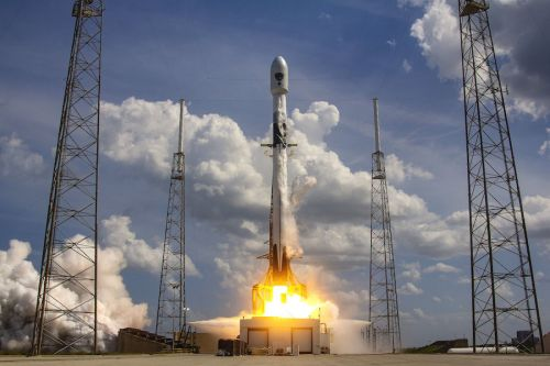 Photos: Falcon 9 rocket launches from Florida with GPS navigation satellite