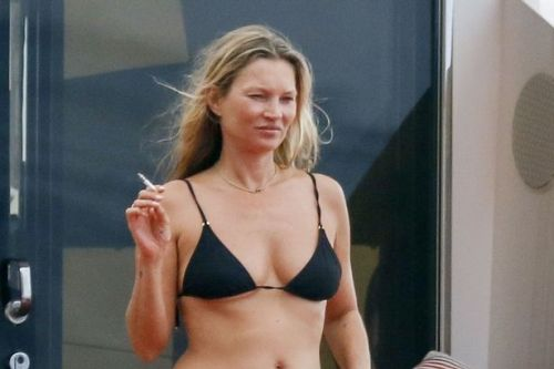 Kate Moss smokes fag on luxury yacht with toyboy and mini-me daughter Lila-Grace