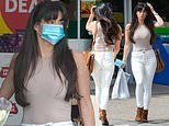 Casey Batchelor wows in clingy top and white jeans as she picks up essentials at a petrol station