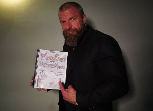 Triple H praises seven-year-old WWE superfan raising money for NHS with homemade WrestleMania book