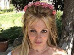 Britney Spears picks roses to put in her hair as she talks about battling acne in her early career