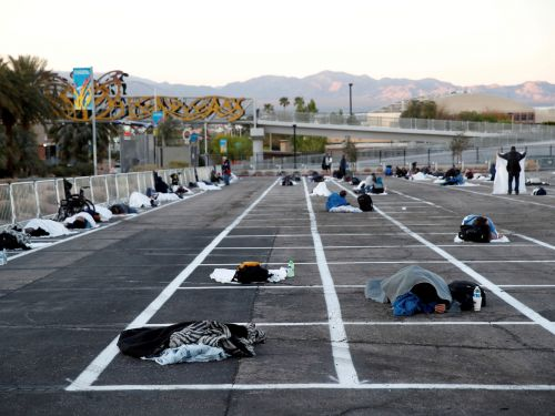 Las Vegas moved hundreds of homeless people to sleep 6 feet from each other in a parking lot after their shelter was hit by the coronavirus