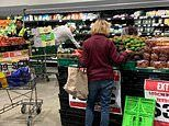 'Social-distance warrior' is pictured shopping at a supermarket with a 2m-long tape measure