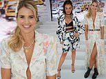 Vogue Williams turns heads in a plunging floral gown at the Paul Costelloe London Fashion Week show