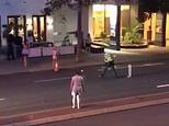 Howzat legal? Cop uses his police car and flashing lights to block a street while he plays CRICKET