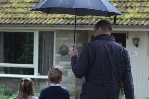 Prince George and Princess Charlotte pictured volunteering in the rain