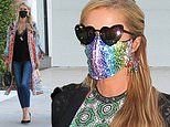 Paris Hilton dazzles in a rainbow rhinestone face mask as she enjoys dinner with family