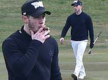 Nick Jonas puffs on a cigar as he plays a round of golf at exclusive Sunningdale Club near Windsor