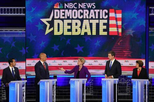 Ten Democrats clash in first US presidential TV debate marred by tech issues and branded 'BORING' by Donald Trump