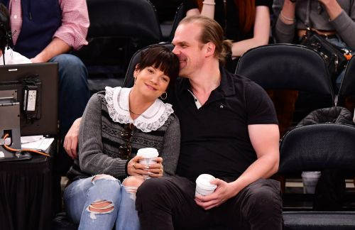 Lily Allen and Stranger Things' David Harbour look smitten as pair pucker up at basketball game