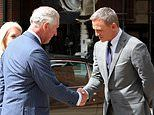 The name's Charles. Prince of Wales meets Daniel Craig on visit to Bond set