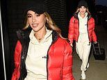 Love Island'sJoanna Chimonides cuts a casual figure in cream loungewear and a a red puff jacket