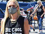 Gwen Stefani rocks sleeveless black T-shirt and Vans during grocery run with three sons in LA