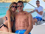 John Terry poses with bikini-clad wife Toni during scenic boat ride during trip to Portugal