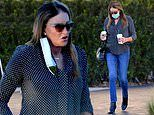 Caitlyn Jenner cuts a chic figure as she kicks off the week by fetching coffee with a friend