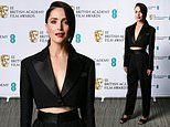 Rose Byrne cuts sharp figure in a midriff-bearing tailored suit as she steps out to celebrate BAFTA