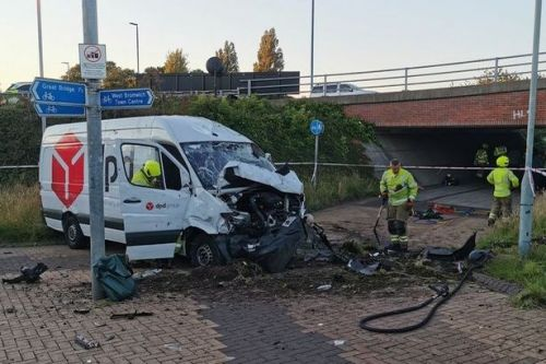 Driver, 26, arrested after DPD van smashes through barrier and falls off bridge