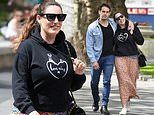 Kelly Brook looks casual chic in floral skirt and hoodie as she cosies up to boyfriend Jeremy Parisi