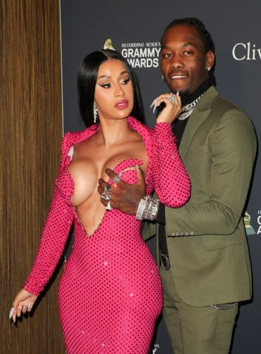 Cardi B wears a VERY revealing low-cut dress to pre-Grammy gala. and her husband Offset can't keep his hands off her