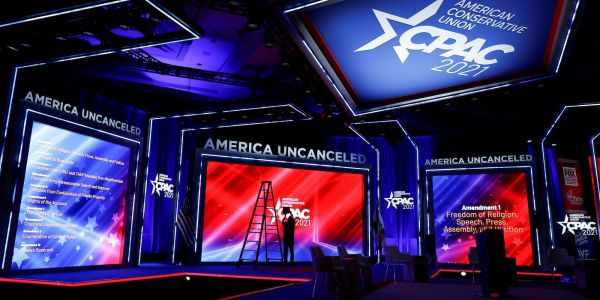 The design company behind the stage at CPAC said they had 'no idea' it resembled Nazi insignia