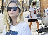 Ashley Benson goes casual chic with Iggy Pop album T-shirt, cherry pattern skirt and black boots