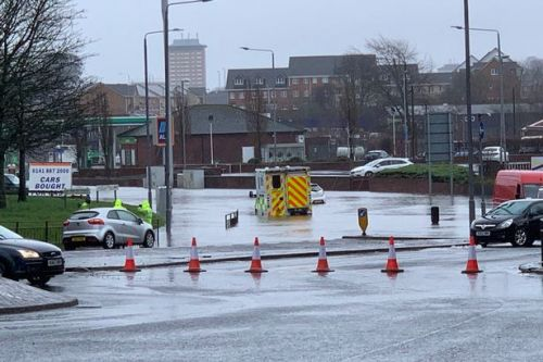 Ambulance stranded in flood water in Paisley as heavy rain and wind causes travel chaos