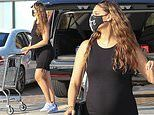 April Love Geary hits up the grocery store again in Malibu in a skintight LBD showing off her curves