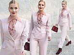 Lady Kitty Spencer looks glamorous in a pink fitted suit as she arrives at Milan fashion week