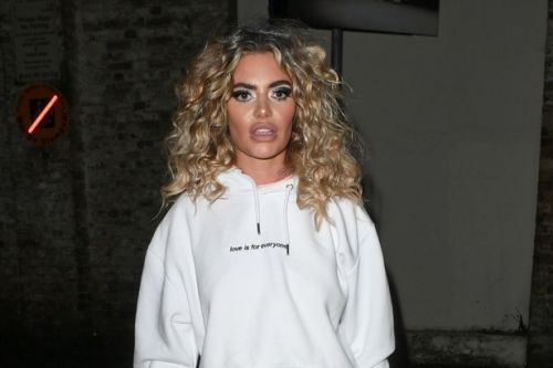 Megan Barton Hanson flaunts gorgeous curly hair as she steps out in miniskirt