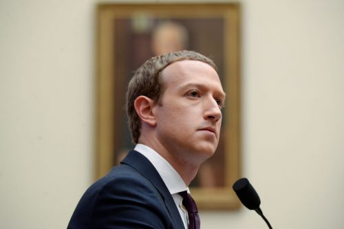 Satirical websites are testing Facebook's policy on not being the 'arbiter of truth' by running false headlines claiming Mark Zuckerberg is dead or abusive