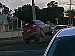 Melton South road rage attack caught on camera as driver tips Haval onto two wheels in Melbourne