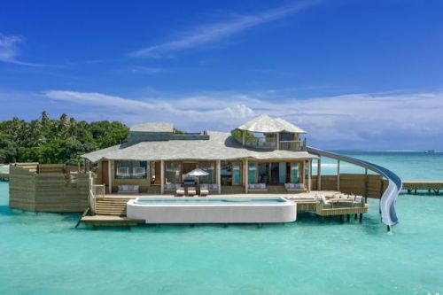 Incredible new water villas open where guests have private slides into the ocean