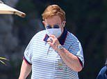 Sir Elton John dresses up in Gucci for lunch in Cannes with husband David Furnish and their two sons