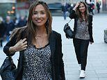 Myleene Klass cuts a chic figure in leopard print top and blazer