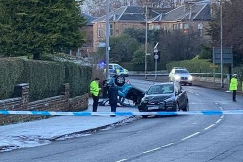 Two people rushed to hospital after car flips onto roof in Glasgow crash