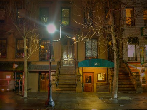 On the 100th anniversary of Prohibition, step inside the iconic NYC speakeasy that's hidden in an unmarked brownstone just steps away from the bustle of Times Square