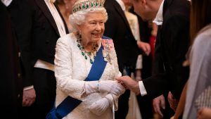 This is why the Queen wears gloves inside Buckingham Palace