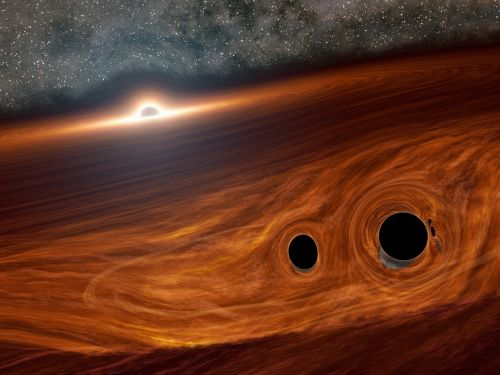 Black holes can produce light when they collide, new research shows - astronomers just saw the first-ever 'flare' from a spacetime-bending merger
